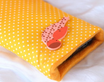 Yellow and orange phone case with dots and small wooden bird