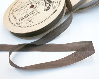 Spool of vintage rayon seam binding. Seamwell, mid century, brown, sewing supplies, crafting.