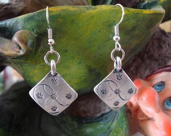 Dangling diamond earrings silver