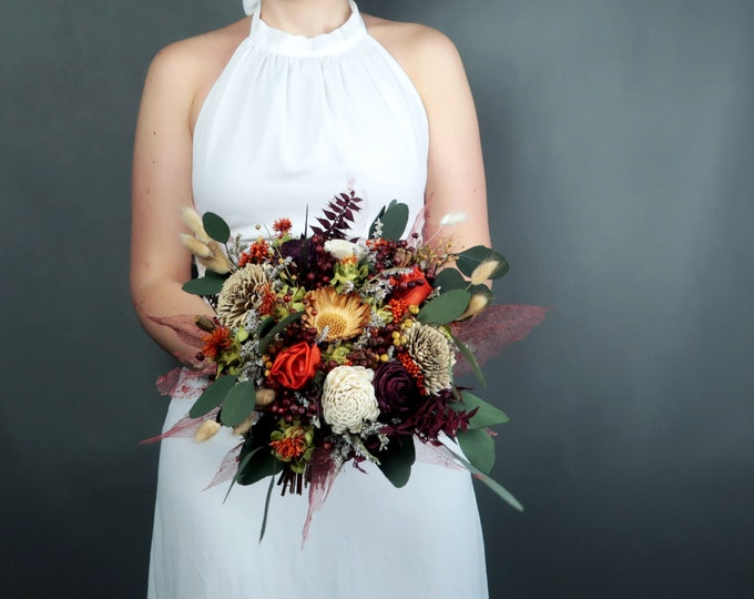 Fall sola flower wedding bouquet in burnt orange, brown, ivory and burgundy