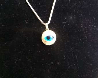 Angry eye put into gold