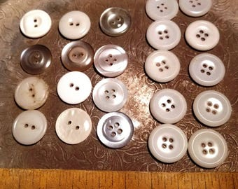 Mix of miscellaneous white, off white, opalescent buttons