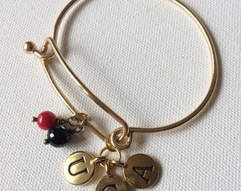 Gold tone UGA charm bangle bracelet
