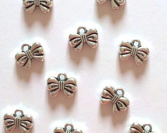 Set of 10 knots T26 silver charms