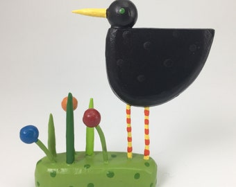 bird in a grassy patch figure | bird sculpture | blackbird | christmas putz | tiny forest | build a forest | woodland scene