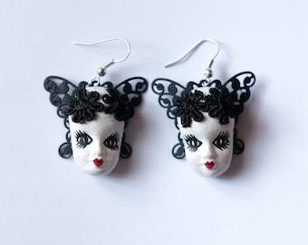 Handmade Dollfaced earrings with wings