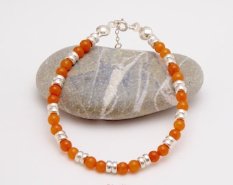 "Sterling silver bracelet "" Bina"" with orange dyed jade pearls and sterling silver interlayers"