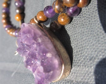 Amethyst Crystal and Tiger Iron Necklace: measuring out what is possible