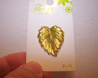 Four green and gold leaf buttons 28 mm or 1 1/8 inches