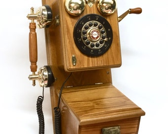 OAK WALL TELEPHONE is a a Bell Touch Tone Reproduction of an Oak Antique Rotary Dial Wall Phone with a Brass Spirit of St. Louis Plaque