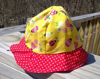 Reversible cotton bucket hat with lady bugs and polka dots.