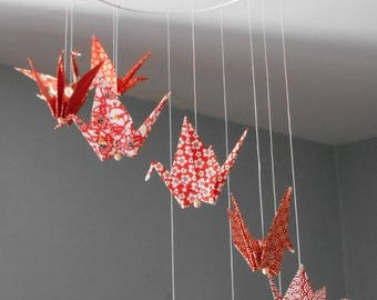 Red spiral origami mobile