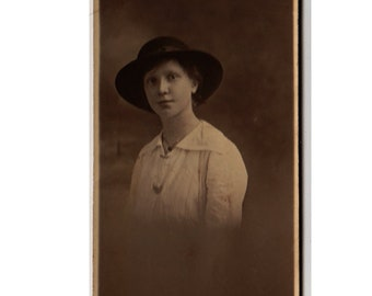antique studio photograph - young Edwardian girl with a dark background - faded partial portrait of unusual long size