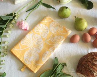 tab tea towel butter yellow lilypad