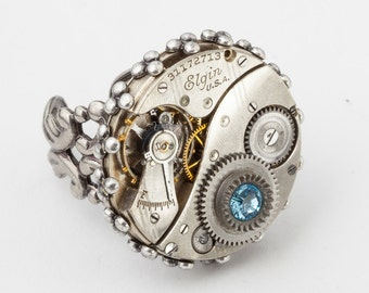 Steampunk Ring vintage watch movement gears blue crystal Neo Victorian silver filigree clockwork Steampunk jewelry by Steampunk Nation