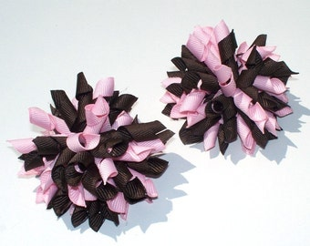 A Pair Of Light Pink And Brown Mini Korker Hair Bows