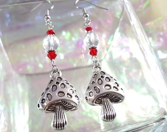 Smurf mushroom earrings with red and transparent beads.