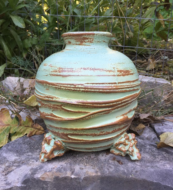 large ceramic vase in pale green and rust brown