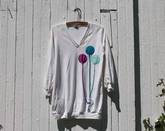 1980s long sleeve tunic shirt, oversized, white with applique balloons in blue and purple, jersey knit, v neck, the twins inc, made in miami