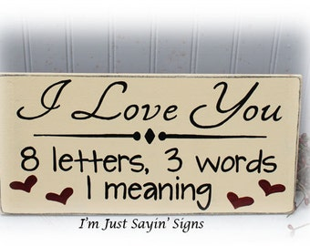 I love you, 8 letters, 3 words, 1 meaning wood sign