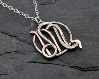 Leo scorpio zodiac necklace sterling silver and polished copper