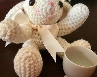 Crocheted amigurumi stuffed bunny rabbit with egg cup