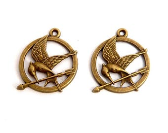 LOT 2 charm ring mocking bird and arrow 25mm bronze hunger games