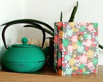 Hand made journal, junkjournal, bullet journal, diary, treasure album with bold colours and patterns, boho design and vintage writing papers