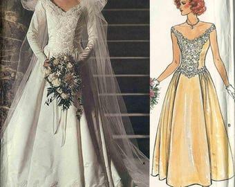 Sewing pattern Vogue 1677 Wedding Dress wide vee neckline lace feature overlay shaped waist two lengths Size 14 Vogue Bridal Original uncut