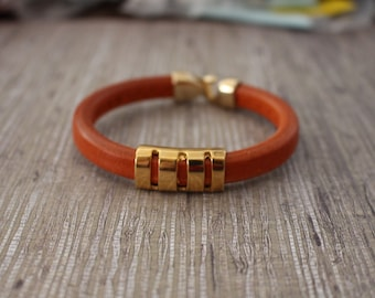 Gorgeous pumpkin licorice leather bracelet with gold accents