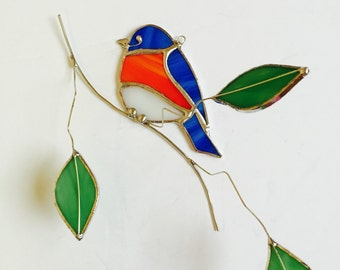 Eastern Bluebird stained glass sun catcher with glass leaves on 3-dimentional wire branches.