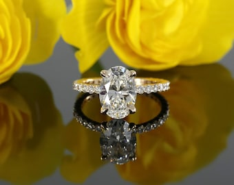 9x7mm Oval Forever Brilliant Moissanite and Diamond Solitaire Engagement Ring in 14k Rose Gold (avail. in white, yellow gold and platinum)