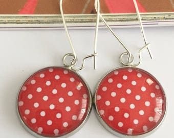 Earrings cabochon white dots on red background