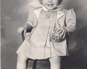 Sweet girl with a rubber ball and 40's era dress ~ Real photo postcard Beverly Marie 1941