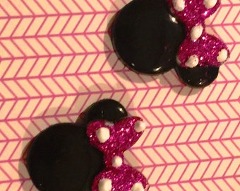Minnie Mouse earrings on nickel free posts with hot pink bow.