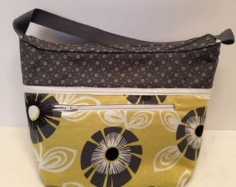 "LIP22- Lunch Bag: ""Yellowing"" Wired"" washable insulated lunch bag with zippered front pocket and zippered top closure."