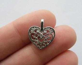 8 Heart charms silver tone H145