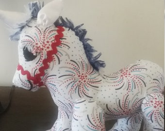 Red white and blue fireworks unicorn