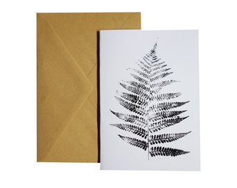Card with black and white monoprint of a Fern leaf. A6, folded, blank inside, with envelope.