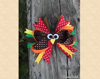 Thanksgiving turkey hair bow with attached barrette on the back.