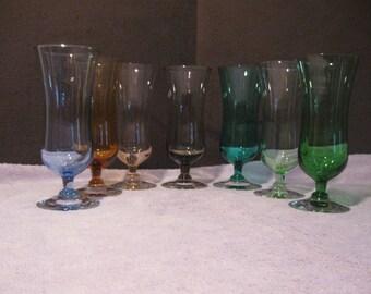 Mid Century Set of Seven Colored Champagne Glasses   Vintage Colored Barware  Seven Different Colored Stemware Glassware