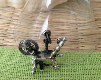 Vintage sterling silver spinning wheel charm