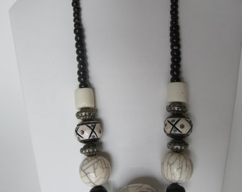 African inspired, beaded black, white and silver necklace