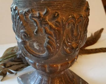 Vase has metallic look but ceramic, nice details