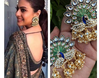 Indian jewelry, traditional jewelry, handcrafted earrings, gold plated celebrity peacock earrings lined with fine pearls