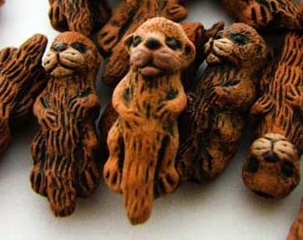 4 Tiny Otter Beads - CB45