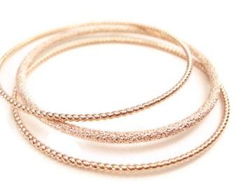 Rose Gold Bangle Set Stacking Stardust and Twisted Ribbon Bracelets