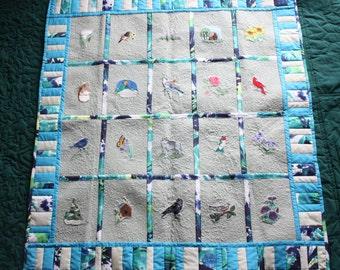 Lovely  lap or wall  quilt   embroidered with florals , animals ,and birds