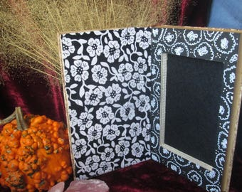 Hollow Book. Your hand. Painted book. Flowers.