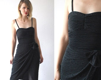 SALE...80s little black dress. 40s style party dress. wrap dress with bow - small
